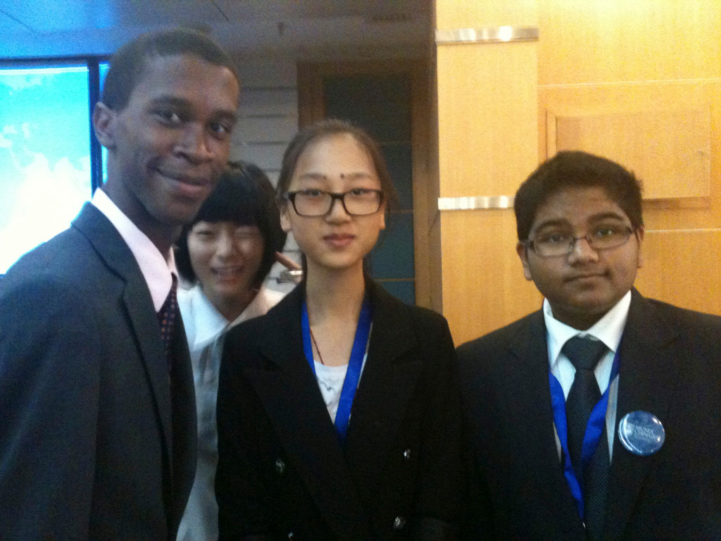 17-year-old Justin Andrews with international delegates at Model U.N. conference in Beijing.
