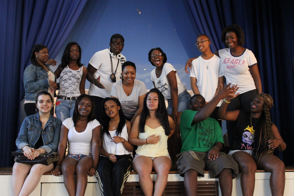 The Hallway cast, surrounding director Sharna Jenkins, center, are, clockwise from top left, Jacqueline Edward, Nydia Hood, Joshua Adams, Brittani Samuels, Guerlain Gureer, Georgie-ann Getton, Symphoni Flowers, Trevon Williams, Taty Diaz, Janaiai Jenkins, Alexandra Auguste and Rebecca Pissalidis.