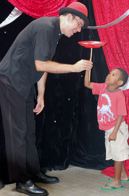 Magician Lou Johnson taught Bryce Barbot a plate-spinning trick.