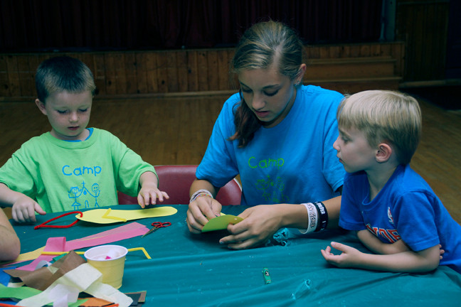 Counselor Ariana Troiano helped campers Jamison Morrissey and Henry Kasschan with their craft projects.