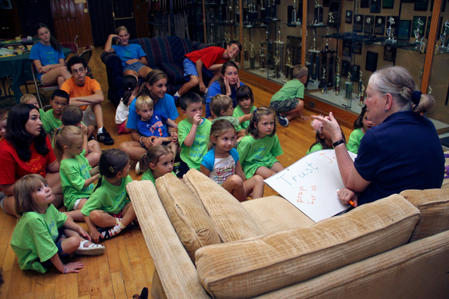 "Pat ""Mrs. D"" Dougherty, talks to campers about Bible stories."