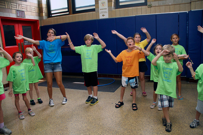 Campers at the Our Lady of Lourdes summer vacation Bible school, which recently ended after two weeks, practiced for a closing performance of songs and skits for their families.