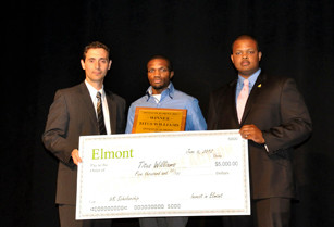 Titus Williams, center, with Chamber of Commerce members Muzzio Tallini, left, and Carl Achille, was the 2012 winner of Invest in Elmont.