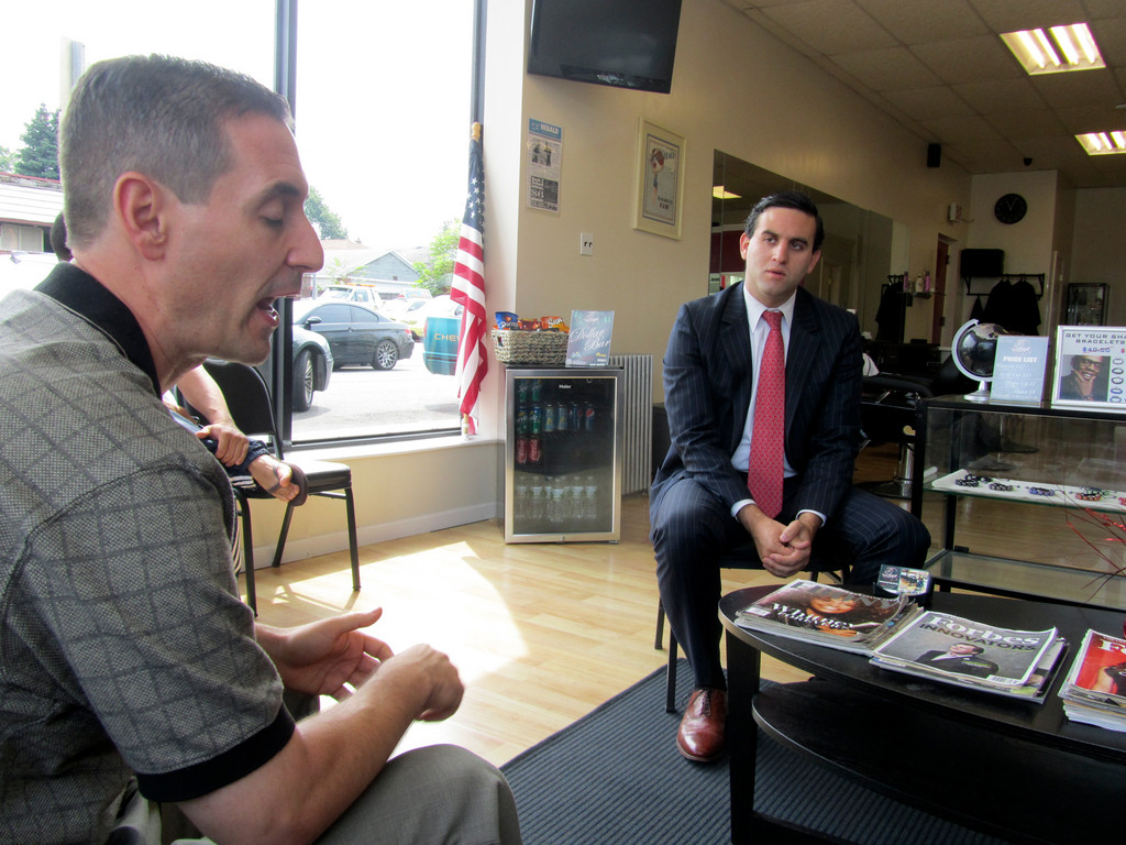 "Chamber member Muzzio Tallini, left, spoke about ""Invest in Elmont"" at The Shop on Hempstead Turnpike as New York State Senate hopeful Daniel Ross listened."