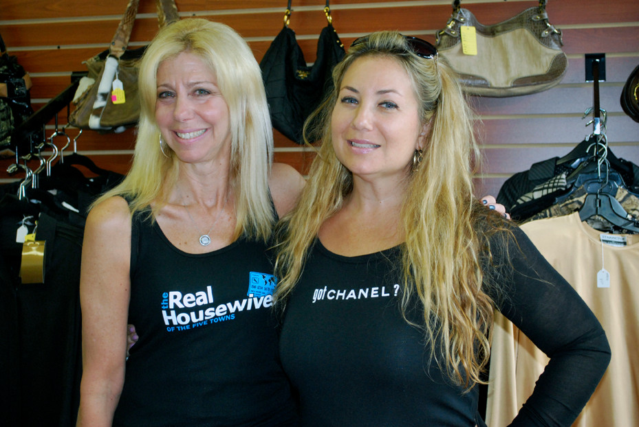 "Sales associate Shelly Schoenfeld, left, and co-owner Debi Rudensky, right, model T-shirts available for sale, including the made-for-the-store ""The Real Housewives of the Five Towns."""