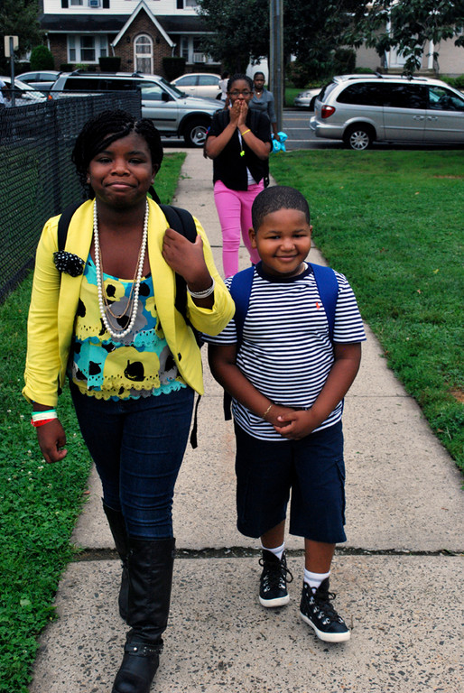 Sherese Arne, a 6th grader, and Jaden Frederique, a 1st grader, headed into school in Elmont.