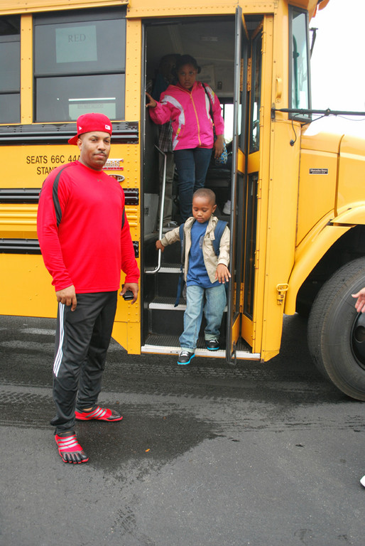 Dad, Chris Muhammad waited for son Khalil and daughter Courtney to get off the bus and head off into Dutch Broadway School.