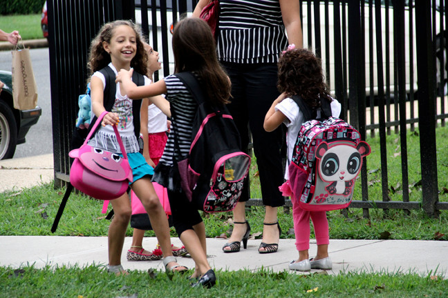 Ava D'Arduini, left, and Gabriella Mendolia rushed to greet each other on their first day of school in Franklin Square.