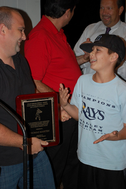 Thomas Marten of the Rays was all smiles when it was announced that he was selected as the player of the year in the Wright Division. He accepted the award from his coach, Jamie Lewin.