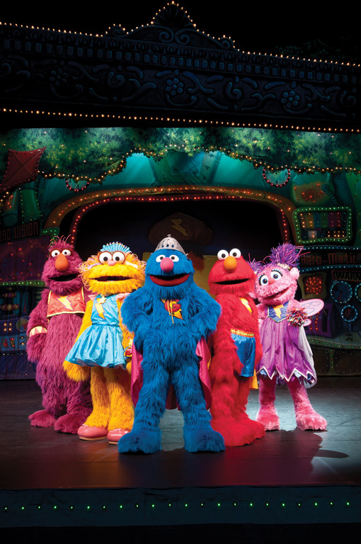 "Elmo and his friends are making music in Sesame Street Live's ""Can't Stop Singing."""