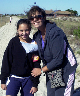 Merrick Avenue Middle School seventh-grader Kayla Braccio and her Mom, Audrey, on their way back from cleaning up the beach.