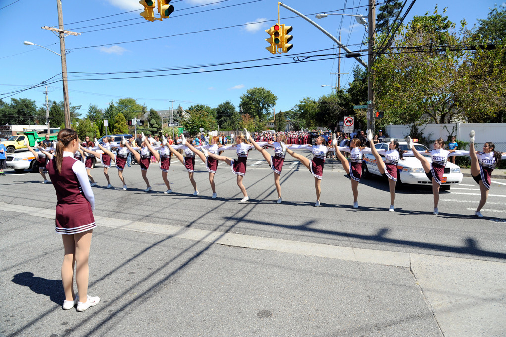 The Mepham kickline team stopped in front of Luigi�s Pizza Restaurant and other locations on the parade route to entertain the crowd.