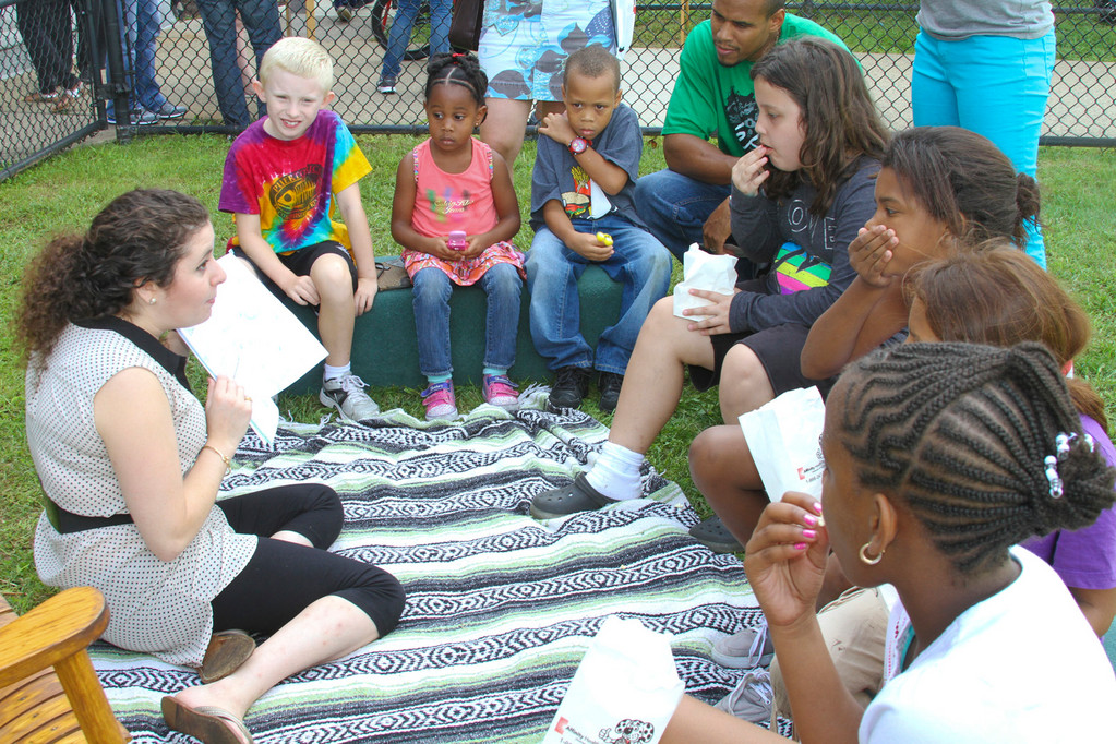 Ariela Rossberg, left, read her book, �The Gray Days,� to children who attended the Community Health Fair at the Number Four School in Inwood on Sept. 9.