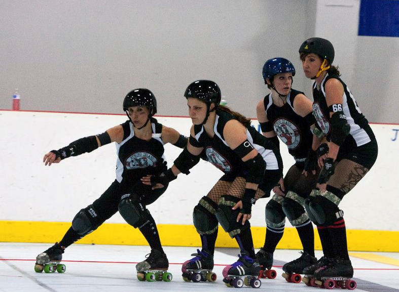 "Roller derby player/coach Andrea Bucciano, second from left above, lives a double life. At home in Baldwin she's a vegetarian book club hostess, but on the rink she is ""Mean Frostine."""