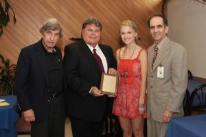In 2011, Elovich, left, and Chamber President Michael Kerr, presented the organization's Student of the Year Award to Shannon Romig, a junior at Long Beach High School, along with LBMC CEO Douglas Melzer.