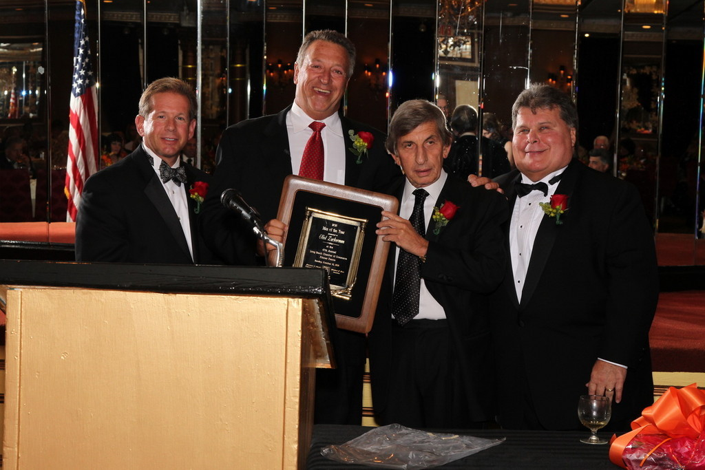 Larry Elovich, second from right, with Warren Vegh, far left, with the chamber's 2010 Man of the Year Elliot Zuckerman, and Michael Kerr.