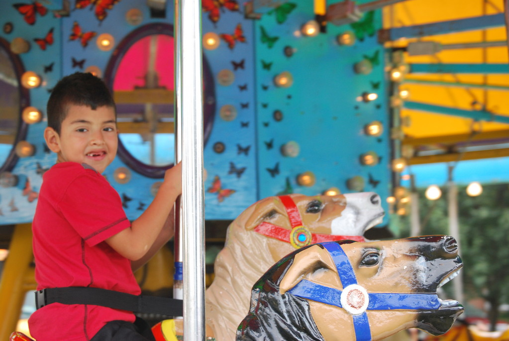 Robhno Reyes, 7, of Cedarhurst appeared to enjouy his time on the merry-go-round at the fair.