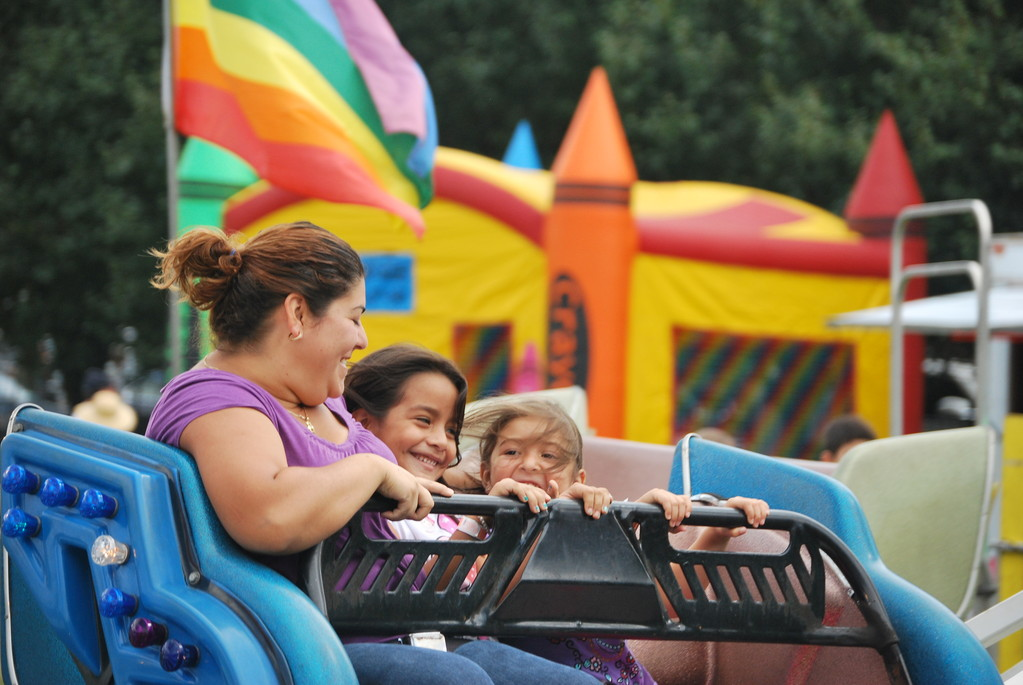 Angie Galiscia, Brianna Vargas,7, and Elizabeth Galiscia, 4, all of Inwood, were whipped around on the Sizzler.