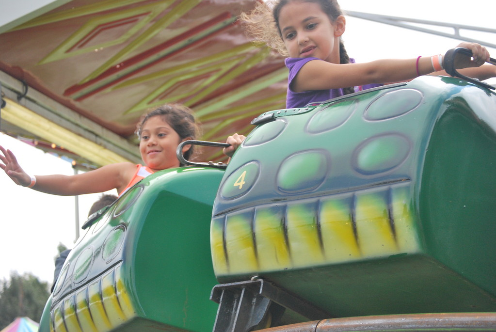 Kids on the Go-Gator waved and looked down at their parents as they went around the ride's tracks.