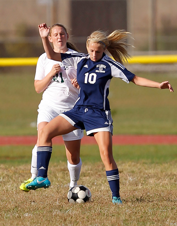 Oceanside's Julia Duffy, right, found the net twice in a 3-2 defeat to Conference AA-I rival Mepham on Sept. 12.