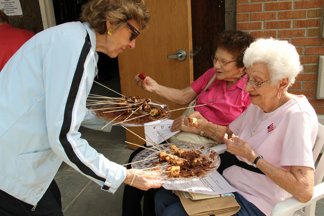 Florence Van Wie offered chocolate bananas and strawberries Ann Puglisi and Ruth Barber.