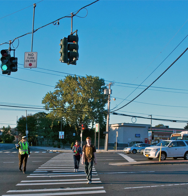 Crossing guard Patricia Erath stopped traffic as East Meadow High School students crossed Hempstead Turnpike.