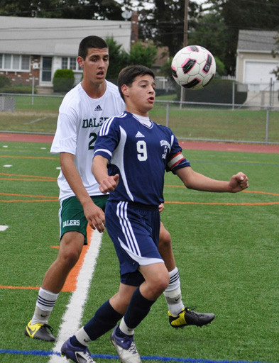 Oceanside's Michael Schmutter, right, controlled the ball in front of Farmingdale's Frank Merklin during the Sailors 2-0 win last Saturday.