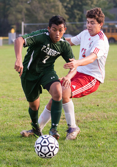 Junior Juan Rivera, left, scored both of Valley Stream North's goals in its 2-1 victory at Mineola on Sept. 27.
