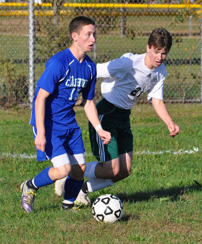 Calhoun's Daniel Chesley, left, who assisted on the game's only goal Monday, looked for a passing lane with Kennedy's Mike Watson defending.
