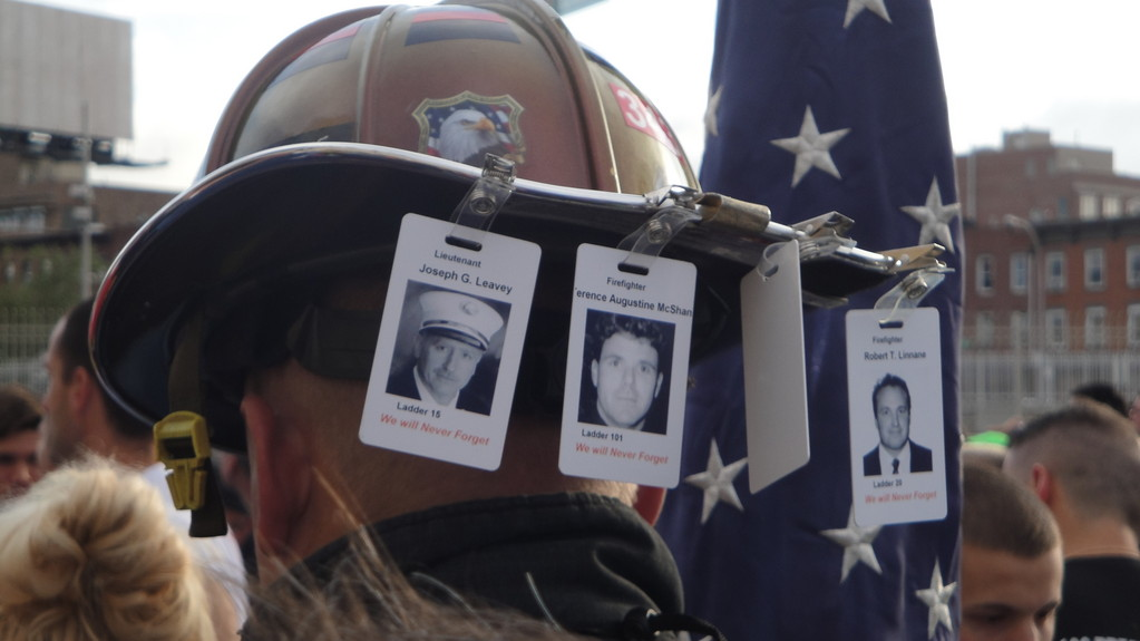 Photographs of firefighters who perished on 9/11 were everywhere to be found at the race/walk, including hanging from firefighters' helmets.