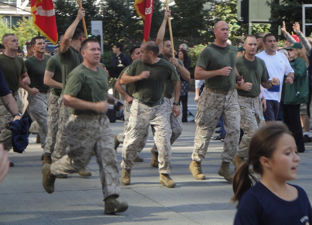 Members of the U.S. military ran in their fatigues and boots.