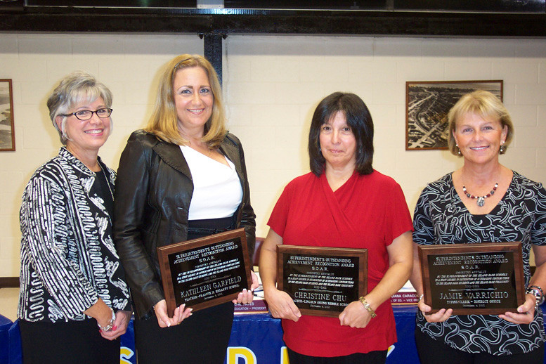 Superintendent Dr. Rosmarie Bovino, left, presented SOAR awards to teachers Kathy Garfield and Christine Chu, as well as receptionist Jamie Varrichio.