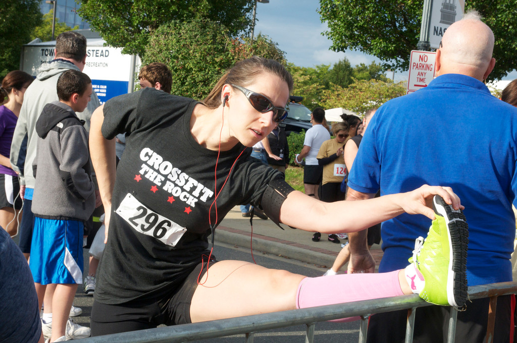 Trainer liz smith from Oceanside warmed up before the 5K.