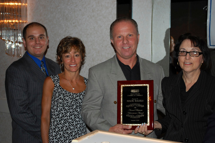 Michael Magioncalda, third from left, owner of Magic Bagels, was presented with the Business Achievement Award by the Valley Stream Chamber of Commerce at its Sept. 27 awards gala.
