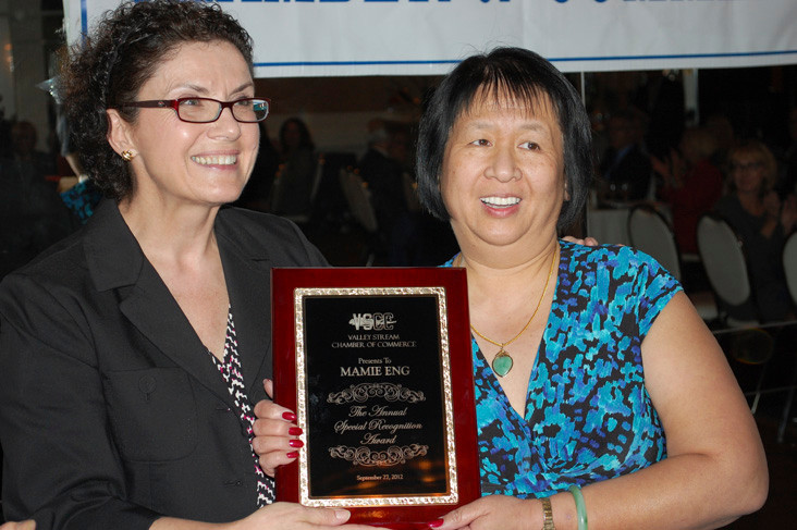 Library Director Mamie Eng, right, receives the Special Recognition Award from former Mayor Joanne Antun.