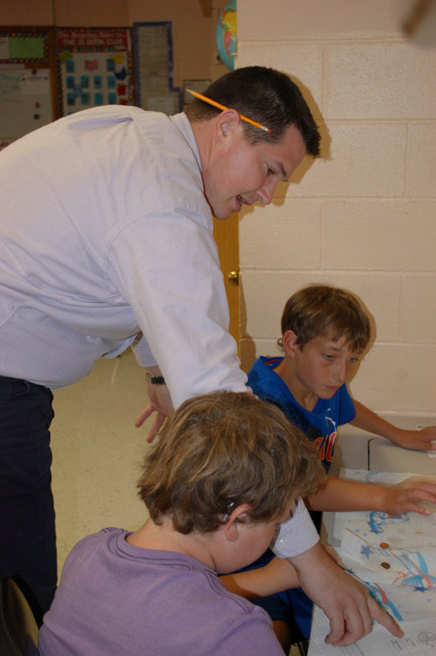 Joseph Schumpf, a sixth-grade teacher at the Buck School, helps Ian Wiltshire and Michael McGuinness with their experiment.