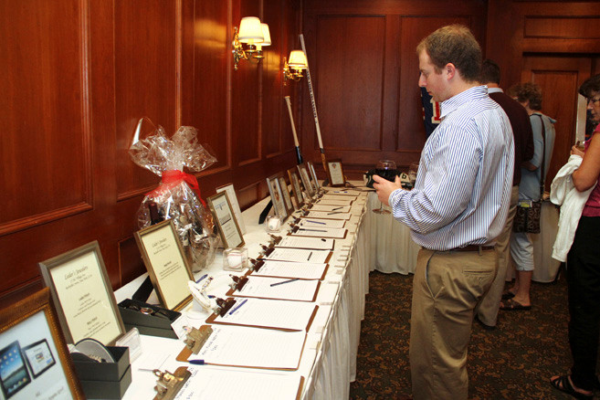 Zachary Adler looked over the silent auction items.