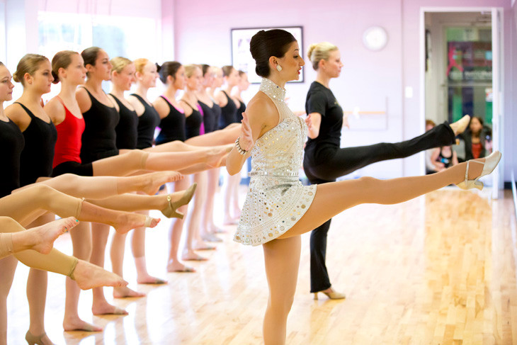Rockettes Stacey Sund, in the foreground and Tara Dunleavy in the black Rockettes t-shirt, led students at Miss Colleen's Elite Dancentre in a master class on Sept. 25.