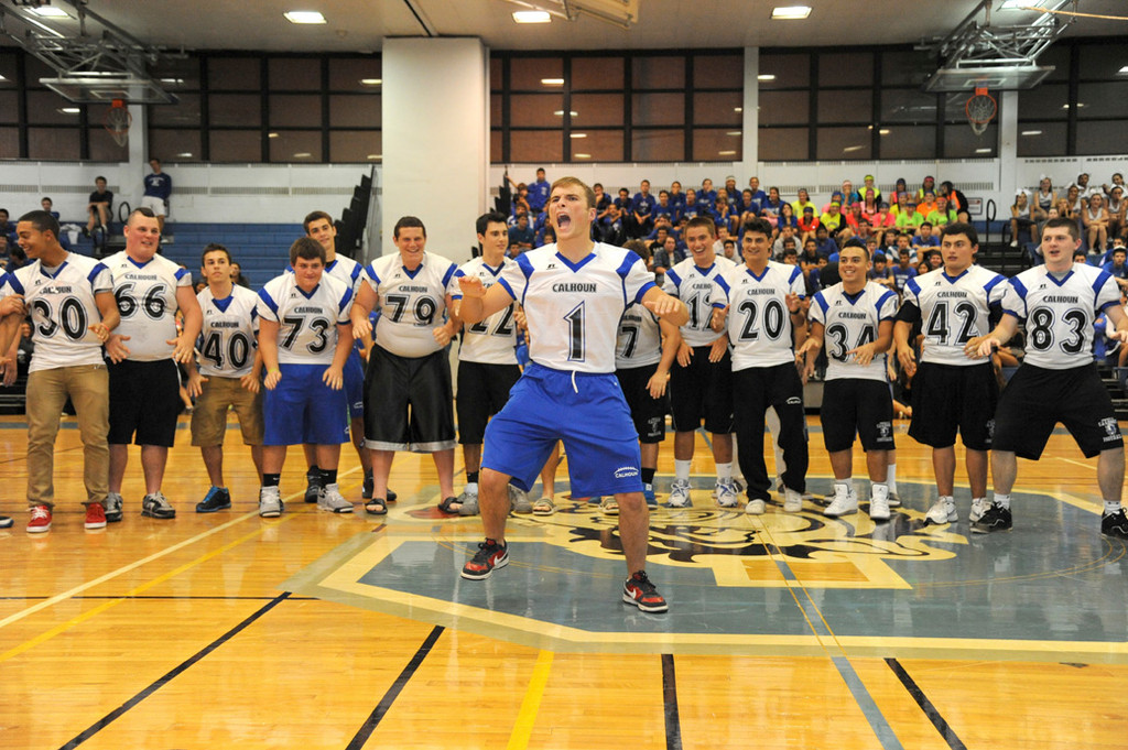 Calhoun High School senior Michael Kotowski led the football team as they pumped up the crowd at the rally.