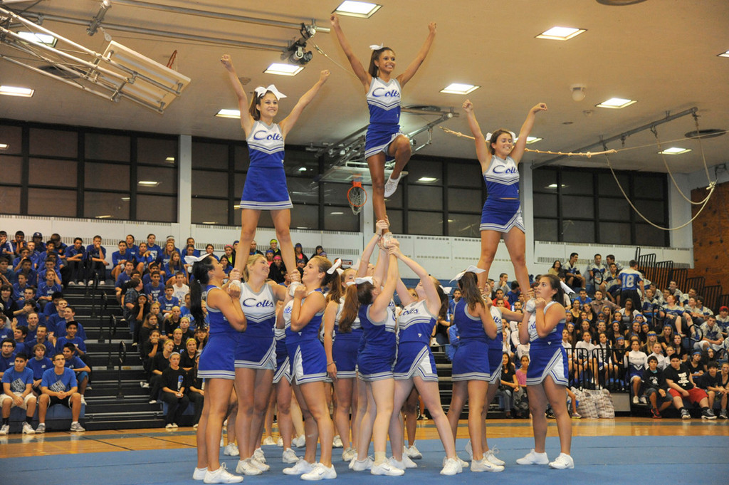 The cheerleading squad fired up the crowd.