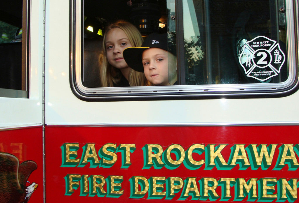 Two young residents enjoyed a ride on the ERFD firetruck at last  year's Fire Prevention Expo.