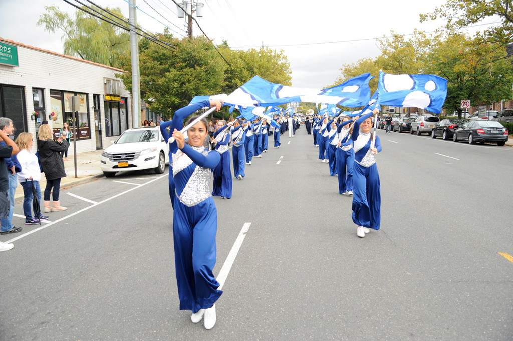 The Hewlett High Scjool marching band color guard helped lead the annual Homecoming parade as it made its way down Broadway in Hewlett on Sept. 29.