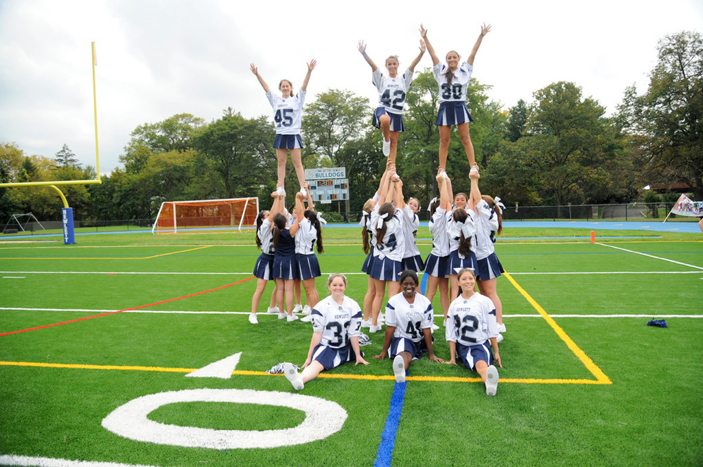 Hewlett's cheerleaders displayed their school spirit as they created three human pyramids.