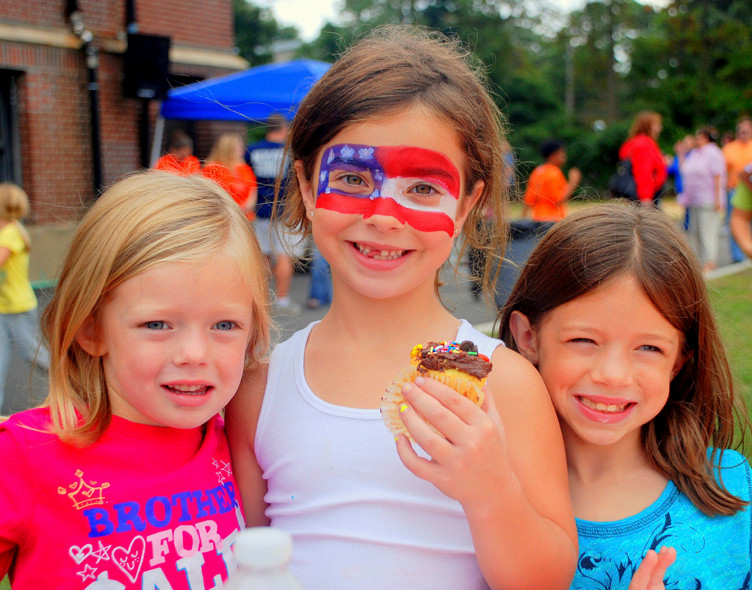 Students Emma Kelly, Katie LaBarbera and Meghan Kelly took advantage of the face painting and the sweet snacks at the annual Centre Avenue Elementary School Back to School