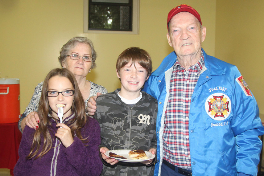 Ella Philbin, 9, showed off her food on the fork at the breakfast with brother, Connor, 12, and their grandparents, Eleanor and Ben Gallagher.
