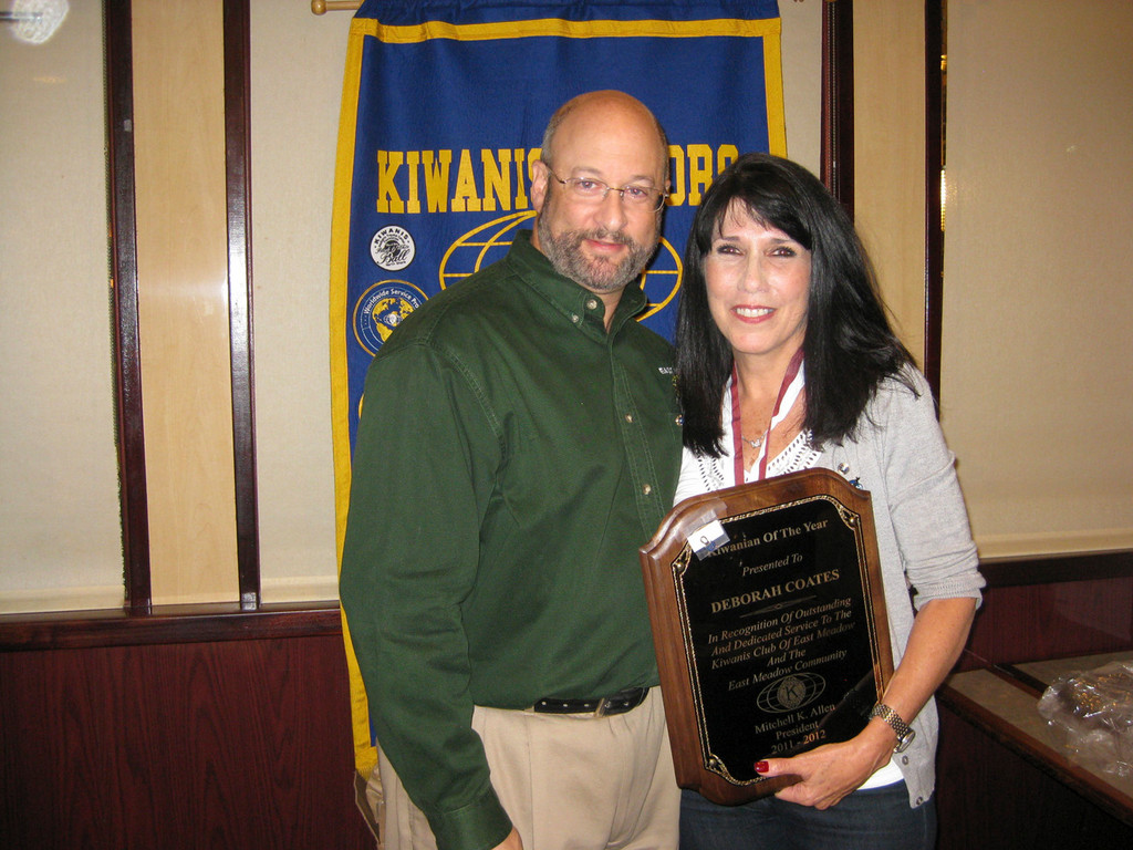 East Meadow Kiwanis President Mitchell Allen presented Debbie Coates with a plaque honoring her as the 2011-12 Kiwanian of the Year.