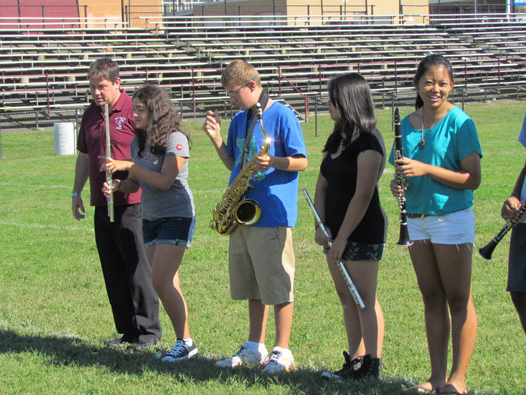 Band Director Kevin Scully, left, showed the students how to space themselves and properly march during parades.