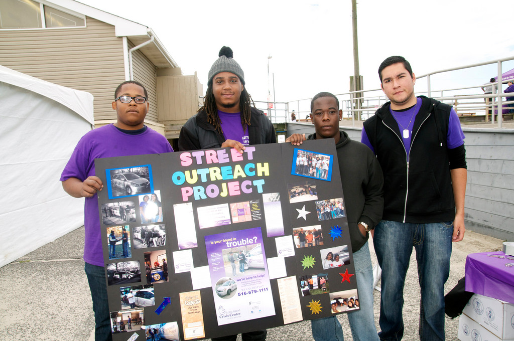 Sebastion Excellent, left, Desmone Sykes, Luis Rivera, and Edward Jones from the Street Outreach Project in Long Beach.