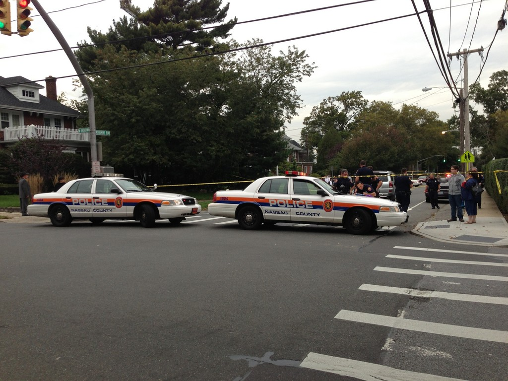 A 22-year-old woman was struck by a vehicle at the intersection of Woodmere Boulevard and West Broadway in Woodmere.