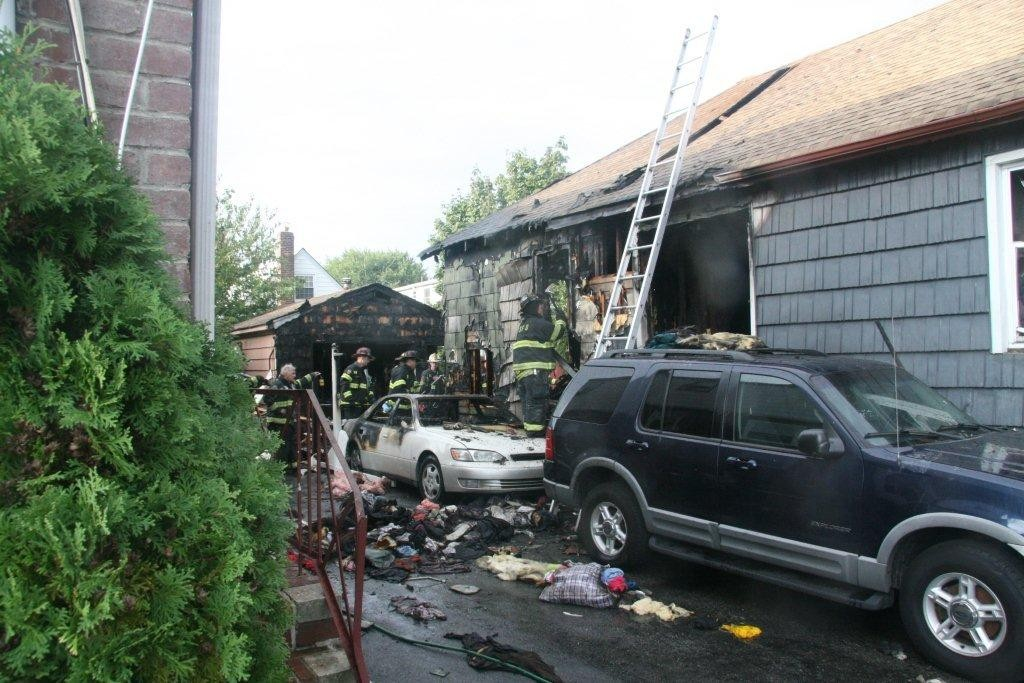The fire, which started in the home's basement, also damaged a car, fence and garage.